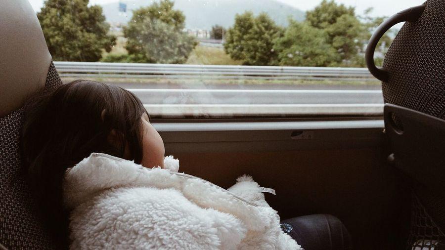 Tired girl sleeping in bus