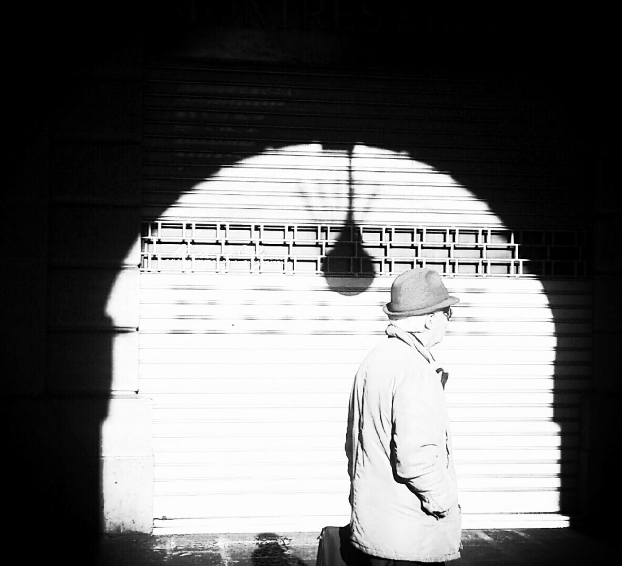real people, one person, rear view, standing, indoors, sunlight, casual clothing, walking, men, built structure, architecture, place of worship, lifestyles, day, shadow, young adult, one man only, adult, people