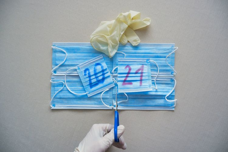 High angle view of hand holding paper against white background