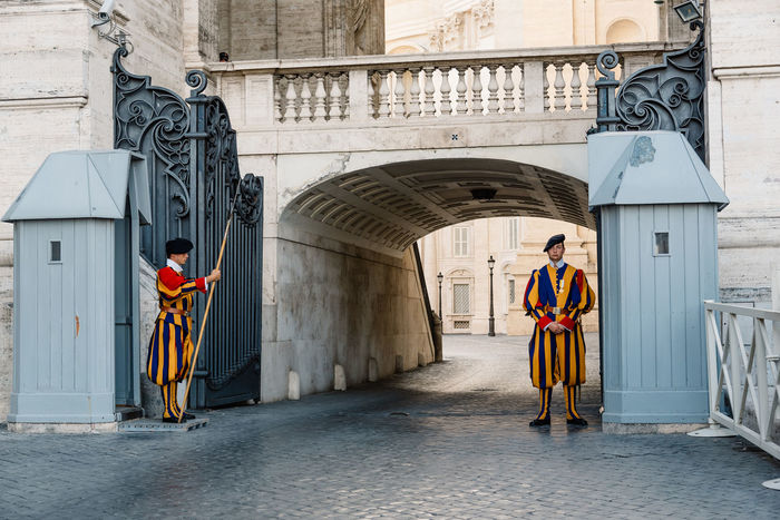 Swiss guards protecting the entrance to Vatican City Adult Adults Only Architecture Building Exterior Built Structure Christianity Day Full Length Guards Men One Man Only One Person Only Men Outdoors People Portrait Protection Real People Rome Standing Swiss Travel Travel Destinations Uniform Vatican