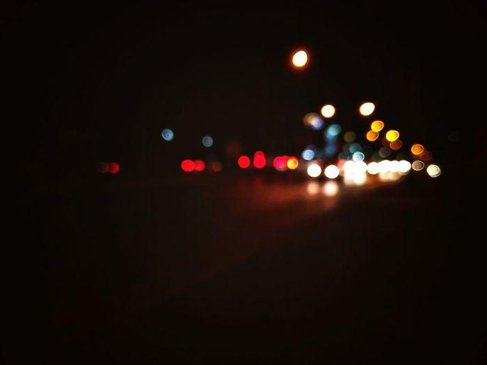 bokeh light on the road Road Bokeh City Defocused Red Car Street Light Headlight