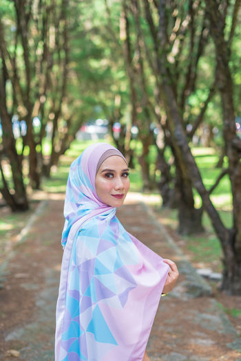 Portrait of lovely young Malay woman, modern stylish Muslim fashion, nature background. Selective focus. One Person Lifestyles Malaysia Malay ASIA Muslim Young Adult Attractive Fashion Modern Wood - Material Wood Forest Beauty In Nature Sky Tree Tranquility Stylish Style Plant People Real People Relaxing Close-up City Nature Mountain Day Hanging Out Growth Green Color Grass Travel Beautiful Portrait Looking At Camera Women Smiling Young Women Land Standing Focus On Foreground Hijab Leisure Activity Headscarf Adult Traditional Clothing Beautiful Woman Outdoors Hairstyle