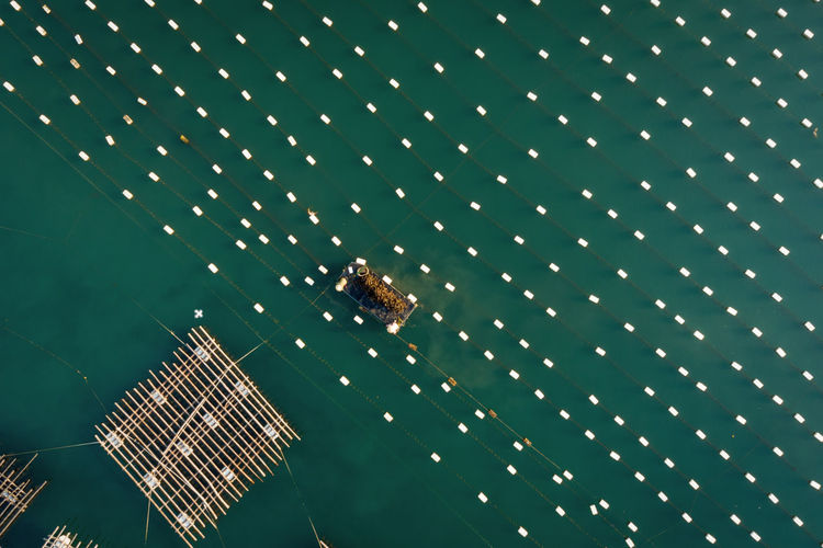 Aerial view of wooden raft on sea