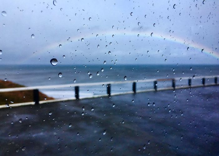 Rainbows 🌈 Rainbow EyeEm Selects Water Drop Wet Sky Rain Nature No People Glass - Material Window Transparent Outdoors Sea Cloud - Sky Dusk RainDrop Day Scenics - Nature Rainy Season Glass