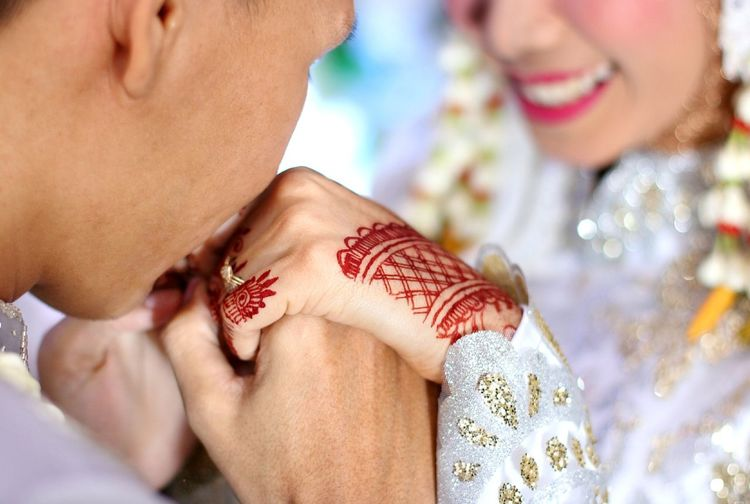 Groom Kissing Hands Of Bride