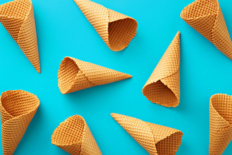 Ice cream cones pattern. Turquoise background. Sweet, summer and empty concept. Top view. Flat lay Backgrounds Blue Background Cold Colorful Cone Dessert Directly Above Empty Frozen Ice Cream Ice Cream Cone Minimal No People Pattern Repetition Summer Sweet Sweet Food Tasty Top View View From Above Wafer Waffle