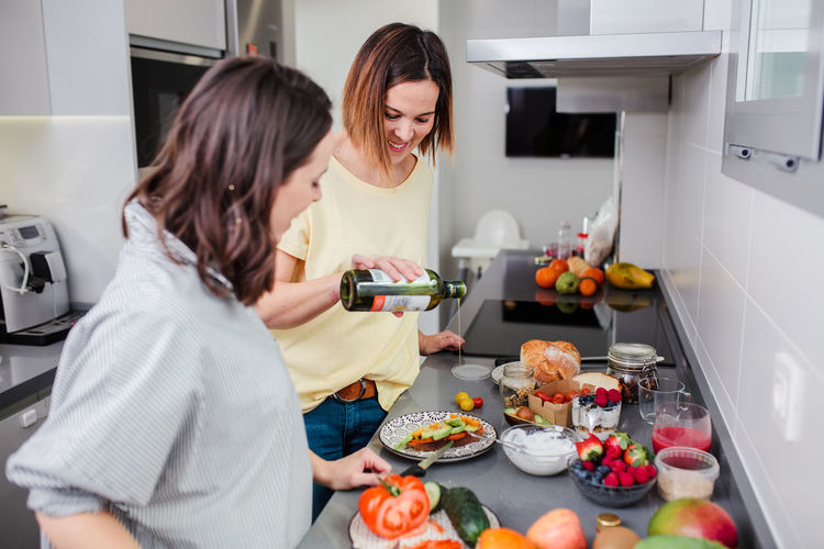 Women preparing food at kitchen