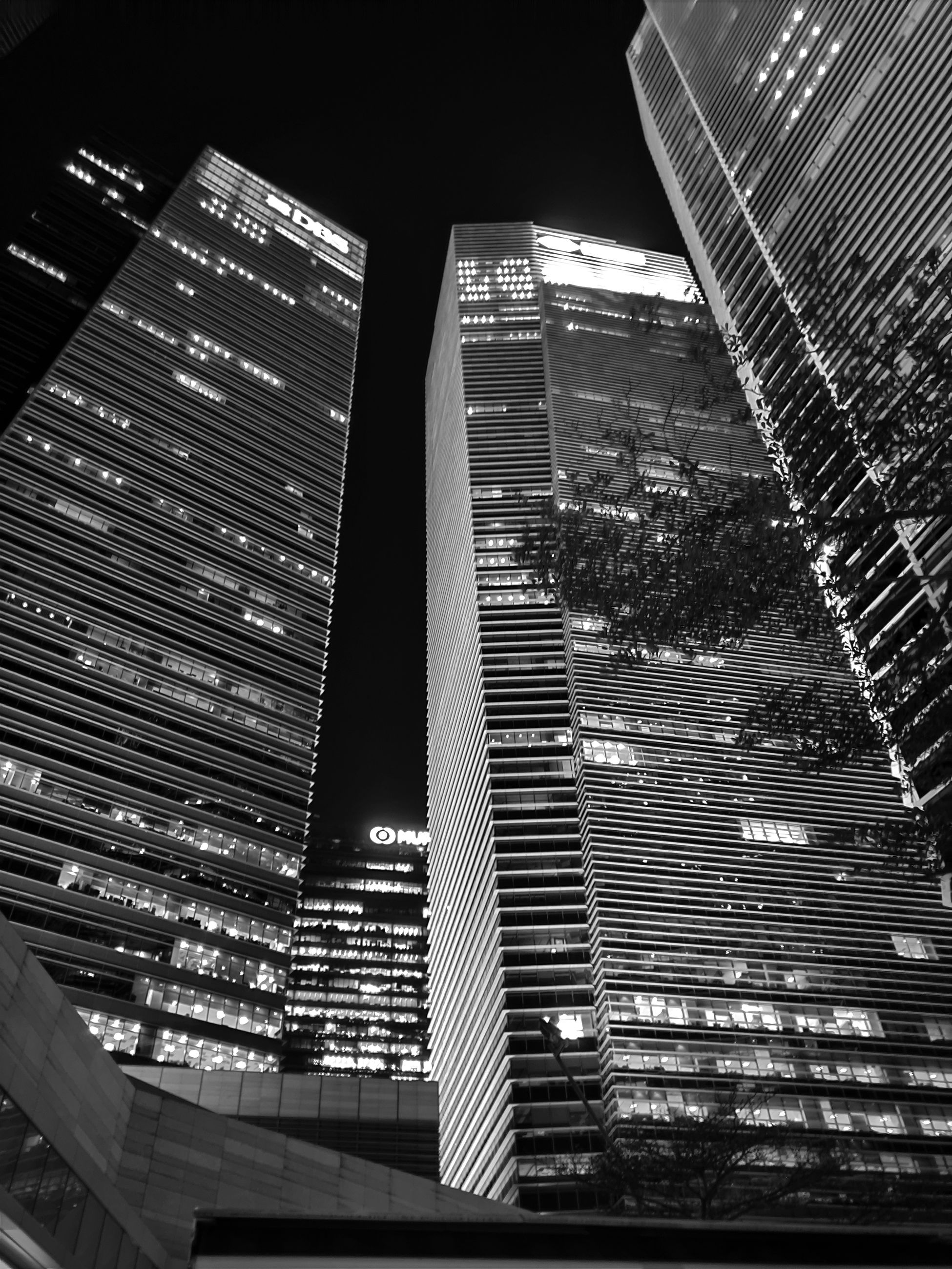 building exterior, architecture, built structure, city, building, office building exterior, tall - high, office, modern, skyscraper, tower, low angle view, illuminated, no people, night, nature, sky, financial district, glass - material, outdoors, cityscape, glass