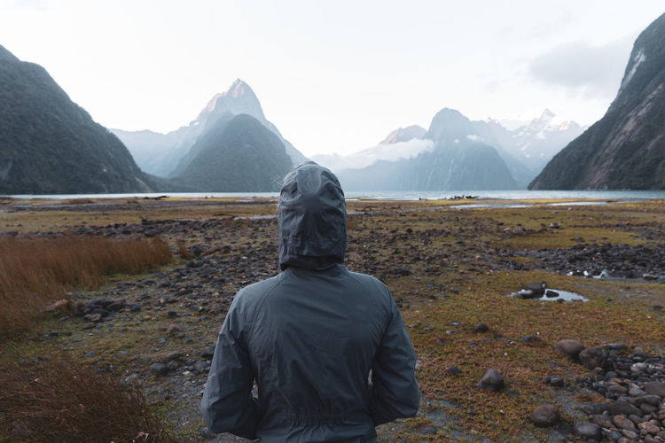 Rear view of person in mountains against sky