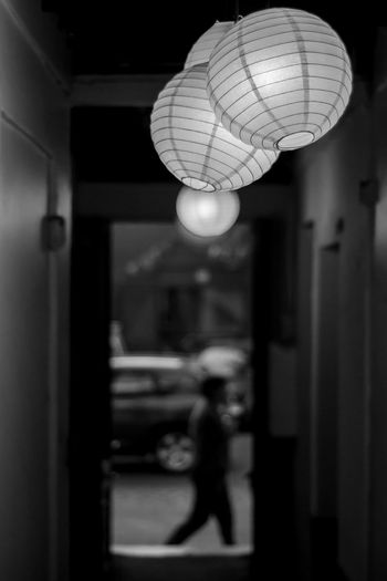 The Street Photographer - 2017 EyeEm Awards Illuminated Indoors  Hanging Celebration Focus On Foreground Built Structure People Architecture One Person Adult Close-up Night Pathway Paper Lamps Asian Lamp