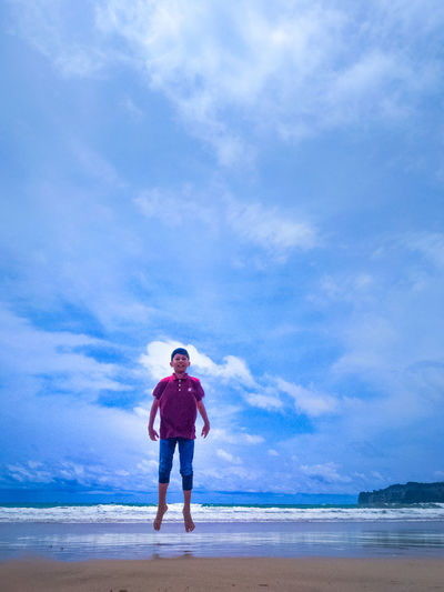 fly INDONESIA Beach Flying Beach Water Full Length Sea Beach Men Blue Sand Standing Sky Horizon Over Water Moments Of Happiness It's About The Journey EyeEmNewHere Redefining Menswear