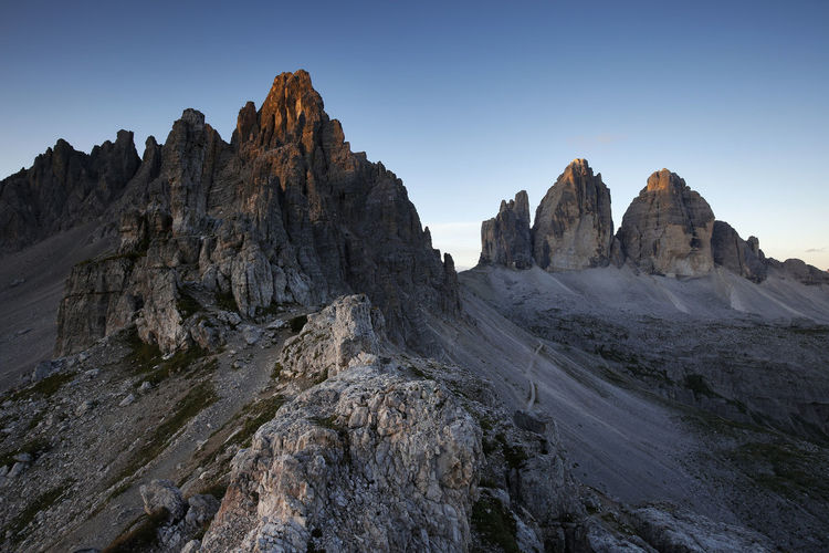 Sunrise at Tre Cime di Lavaredo, Dolomites, Italy Arid Climate Beauty In Nature Clear Sky Climate Environment Eroded Formation Geology Land Landscape Mountain Mountain Peak Mountain Range Nature No People Non-urban Scene Physical Geography Rock Rock - Object Rock Formation Scenics - Nature Sky Solid Tranquil Scene Tranquility