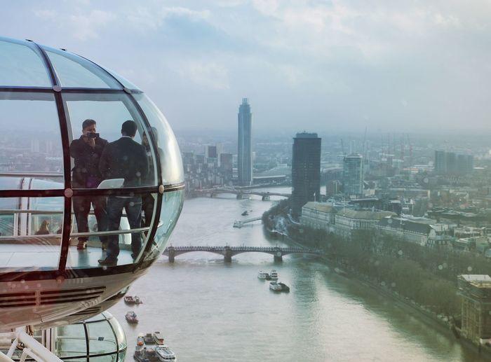 Friends In London Eye Over Thames River Against Sky