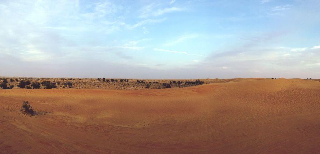 Panoramic view of desert against sky