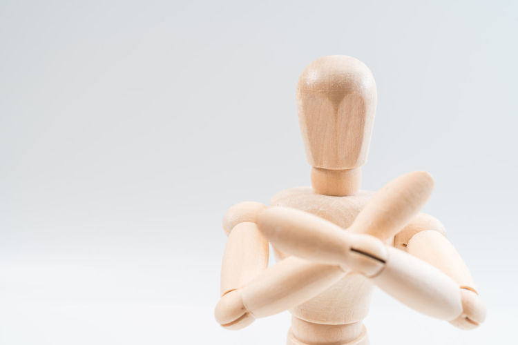 Wood - Material Studio Shot Indoors  White Background Figurine  Close-up Copy Space No People Still Life Representation Human Representation Cut Out Creativity Holding Mannequin Art And Craft Focus On Foreground Toy Gray Brown