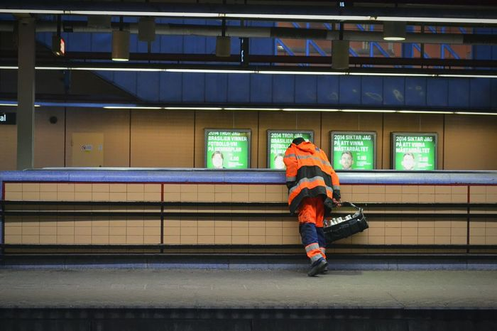 Subway Subway Station Railway Railwaystation Railway Station Underground Workman Work Man Worker Work Working Cloths Orange Yellow Billboard Billboards Blue Stockholm Sweden First Eyeem Photo