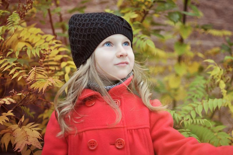 Portrait of girl in hat during winter