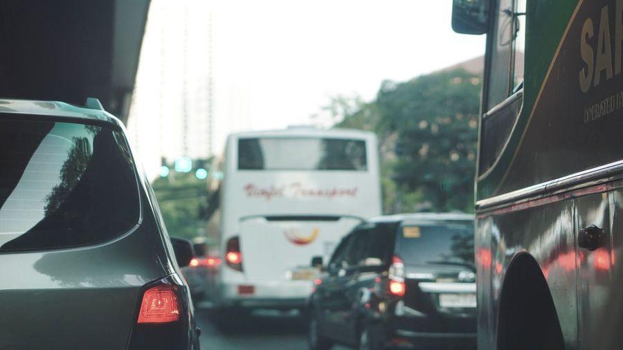 Traffic on road seen through glass window