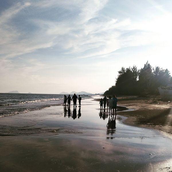 The beach Water Beach Sea Teamwork Reflection Silhouette Sky Cloud - Sky Horizon Over Water