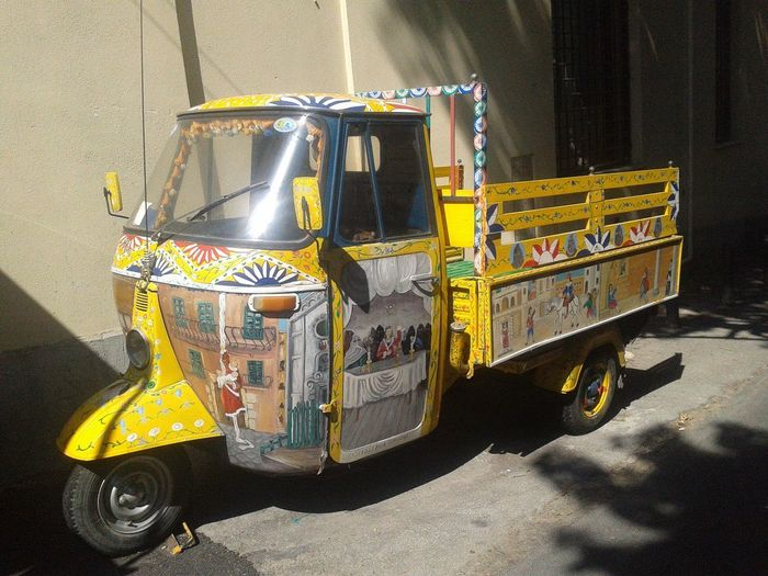 Yellow cart on street in city