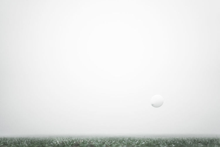 Balloon Day Fliying Fog Foggy Foggy Landscape Foggy Weather Grass Green - Golf Course Minimalism Minimalist Photography  Minimalobsession Nature No People Outdoors Physical Education White Balloons