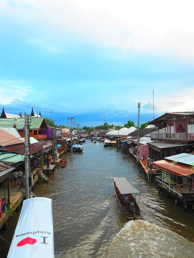 High angle view of boats on canal at floating market in city