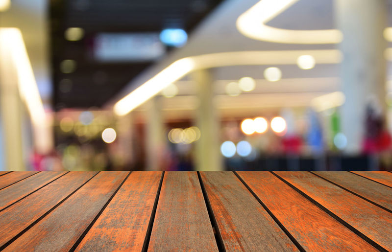 blurred image wood table and abstract people in the shopping mall Shopping; Mall; Retail; Center; Blurred; Crowd; Crowded; White; Busy; Store; Customer; Street; Fashion; Backgrounds; Display; Elevator; Outdoors; Motion; Scene; Male; Women; Window; Rush; Hour; Isolated; Defocused; Business; Urban; Life; Happiness; Friend