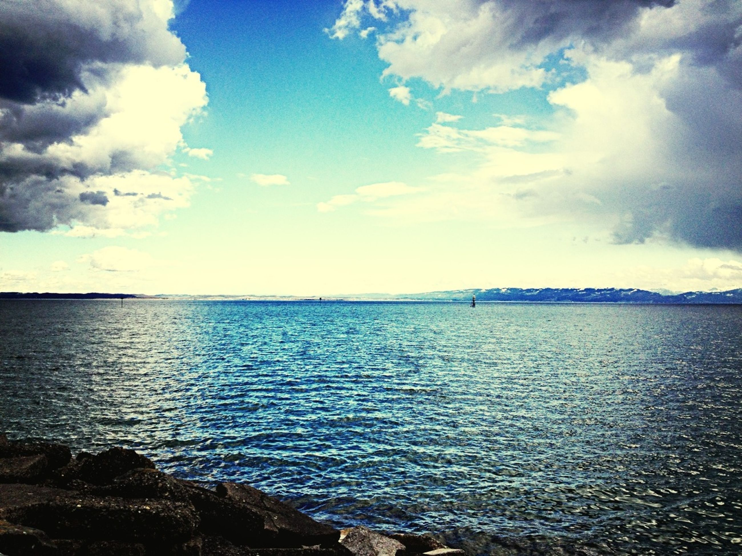water, sea, sky, tranquil scene, scenics, tranquility, horizon over water, cloud - sky, beauty in nature, nature, cloud, rippled, idyllic, cloudy, blue, waterfront, seascape, beach, calm, outdoors