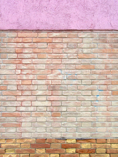 Renovated brick wall Architecture Backgrounds Brick Wall Close-up Day Full Frame No People Outdoors Pink Plaster Reconditioned Renovation Textured