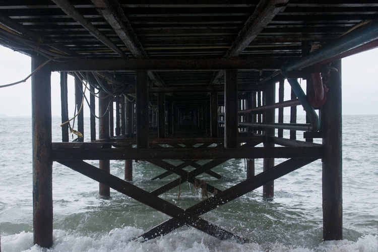 Water Architecture Built Structure Sea Underneath Pier Below No People Horizon Beach Horizon Over Water Land Wood - Material Nature Day Outdoors Connection Remote Architectural Column Lines And Angles Diagonals Wooden Pier Wooden Pillars Thailand