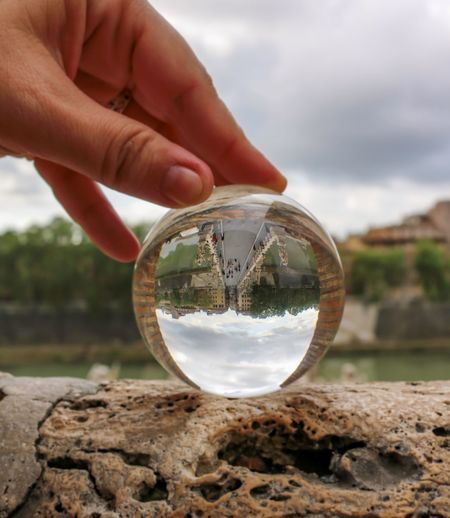 Rom Roma Rome Travel Photography Travelling Citytrip Cloud - Sky Crystal Ball Day Focus On Foreground Glass - Material Human Body Part Human Finger Human Hand One Person Outdoors Photography Photographylovers Reflection Rock Rock - Object Sky Solid Sphere Transparent