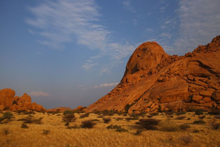 Namibian Landscape in Afternoon Sun Africa Beauty In Nature Day Geology Holiday Landscape Namibia Nature No People Outdoors Physical Geography Rock - Object Rock Formation Scenics Sky Tranquil Scene Tranquility Tree