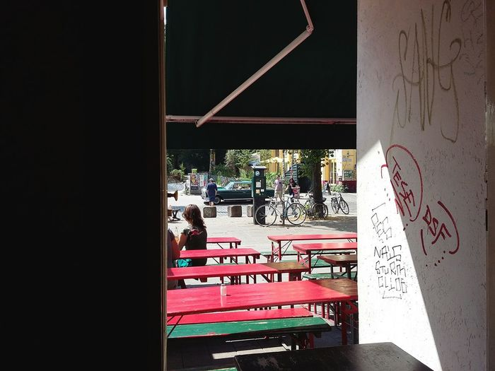 A Look Outside at the Schulterblatt. · Hamburg Germany 040 Hamburgmeineperle Looking Outside City Life Summer People Taking A Break Restaurant At A Restaurant Benches Framed Light And Shadow Urban Landsape Playing Tag