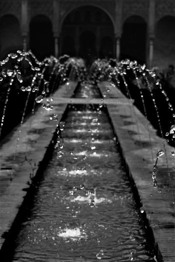 Water flowing in fountain at night