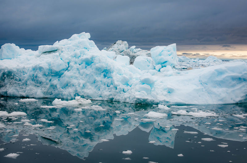Scenic View Of Ice Berg Against Sky During Winter