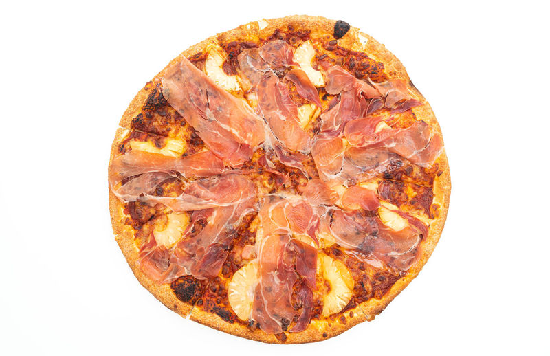 Close-up of pizza on rock against white background