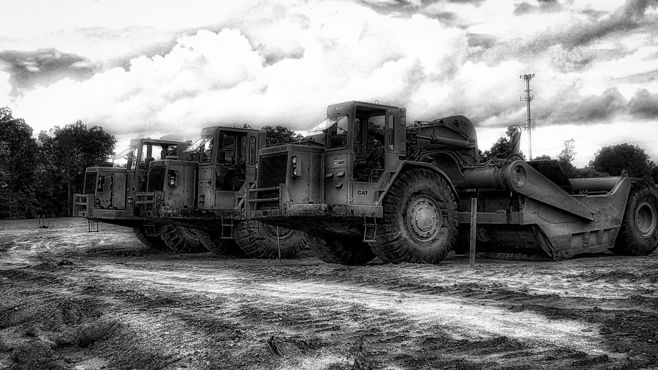 transportation, mode of transport, train - vehicle, steam train, sky, day, land vehicle, outdoors, cloud - sky, freight transportation, locomotive, no people, tree, tire, nature