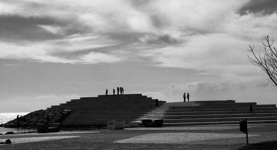 Calm! A Sunday in Durres near the Sphinx build in 2015. Albania EyeEmNewHere Architecture Blackandwhite Building Exterior Cloud - Sky Day Durres Durres Albania Full Length Men Outdoors People Real People Sky Sphinx Steps
