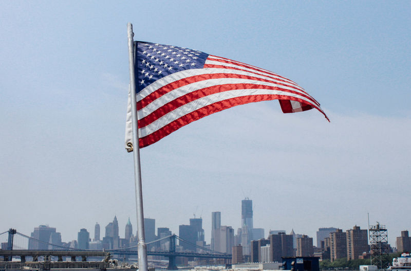 American Flag Against Buildings