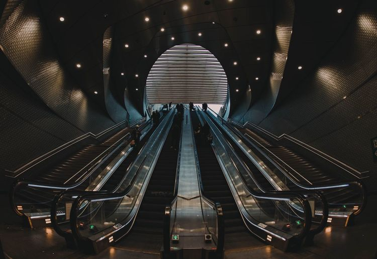 EyeEm Selects EyeEm Gallery Eye4photography  EyeEmNewHere EyeEm Best Shots Escalator Indoors  Illuminated Steps And Staircases Staircase Railing Modern Architecture Steps Transportation Futuristic Convenience The Way Forward Technology Subway Station Built Structure One Person People Day