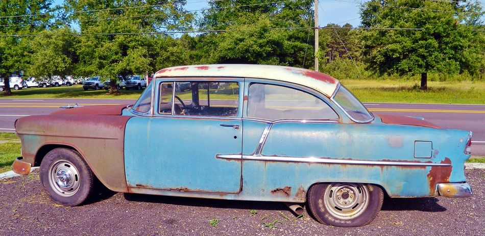 Still a classic 1950's Vehicles Background Blue Sky Car Classic Day Good Old Days Grave Image Of Land Vehicle Mode Of Transport No People Nostalgia Outdoors Parked Pcture Of Photo Of Road Rusty Stationary Tire Transportation Trees Vintage Car White Color
