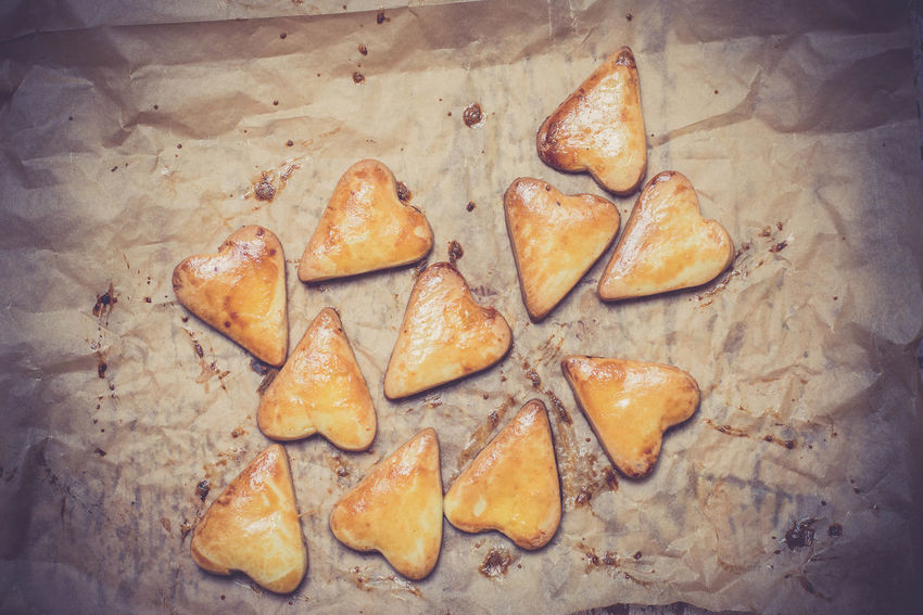 Heart shape cookies on the baking paper Baking Paper Bread Close-up Cookies Crusty Day Dessert Food Food And Drink Freshness Gold Healthy Eating Heart Shape Heart Shape Cookies Indoors  Kitchen No People Ready-to-eat Snack Yummy