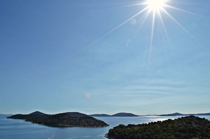 Panoramic view of the little islands at croatia coast Coastline Nature Panorama Panoramic View Adriatic Sea Beauty In Nature Blue Clear Sky Day Island Landscape Mountain Nature No People Outdoors Scenics Sea Sea And Sky Sky Sunlight Tranquil Scene Tranquility Vapor Trail Water