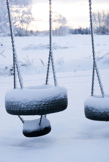 Cold Temperature Winter Snow Frozen Nature No People Beauty In Nature Day Land Ice White Color Focus On Foreground Tranquility Rope Swing Field Chain Tranquil Scene Covering Outdoors Icicle Swing With Snow