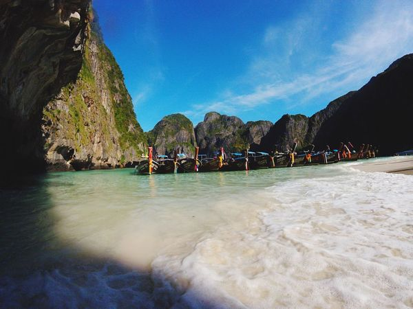 Once known as the most beautiful place on earth....maya bay,Thailand. Mayabay Maya Bay Thailand First Eyeem Photo EyeEm Best Shots EyeEm Nature Lover Mountains Island Desertisland The Beach  Lifes A Beach Longtailboat Boat Tide Shore Beach Simplicity Tranquility Sea Lagoon Nature  Nature_collection Nature Photography Naturelovers