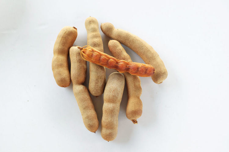 High angle view of sausages against white background