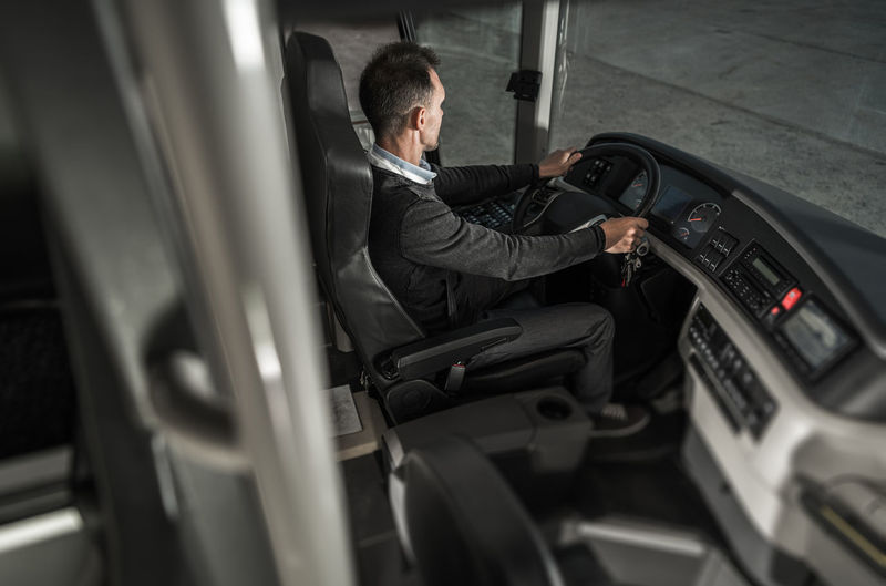 Side view of man sitting in bus