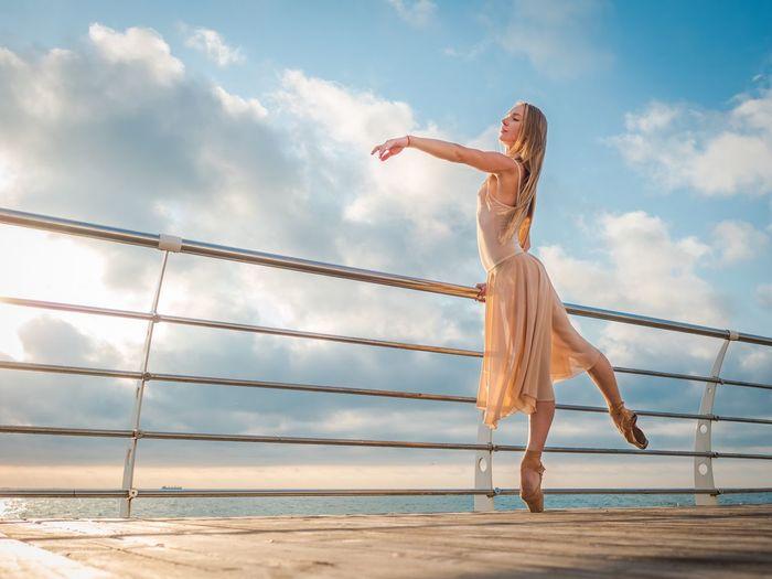 Full length of woman against sky