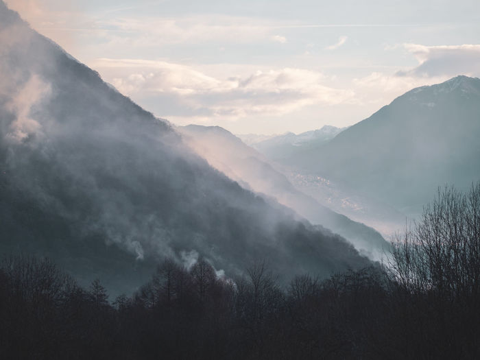 EyeEm Nature Lover Italy Lombardia Alps Lago Di Como Lake Como Nature No People Mountain Scenics - Nature Outdoors Forest Fire Beauty In Nature Tree Cloud - Sky Plant Tranquility Sky Tranquil Scene Fog Non-urban Scene Mountain Range Environment Landscape Idyllic Day Forest Hazy  Mountain Peak