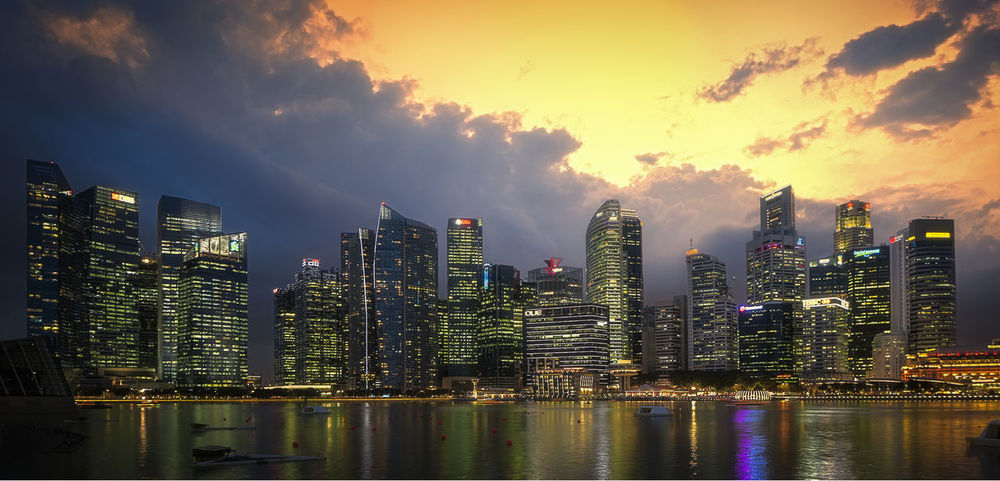 Singapore at night and beautiful sunset Architecture Beauty In Nature Building Exterior Built Structure City Cityscape Cloud - Sky Downtown District Illuminated Modern Nature Night No People Outdoors Reflection River Sky Skyscraper Sunset Travel Destinations Urban Skyline Water Waterfront